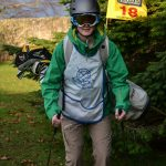 Person in ski gear with golf clubs