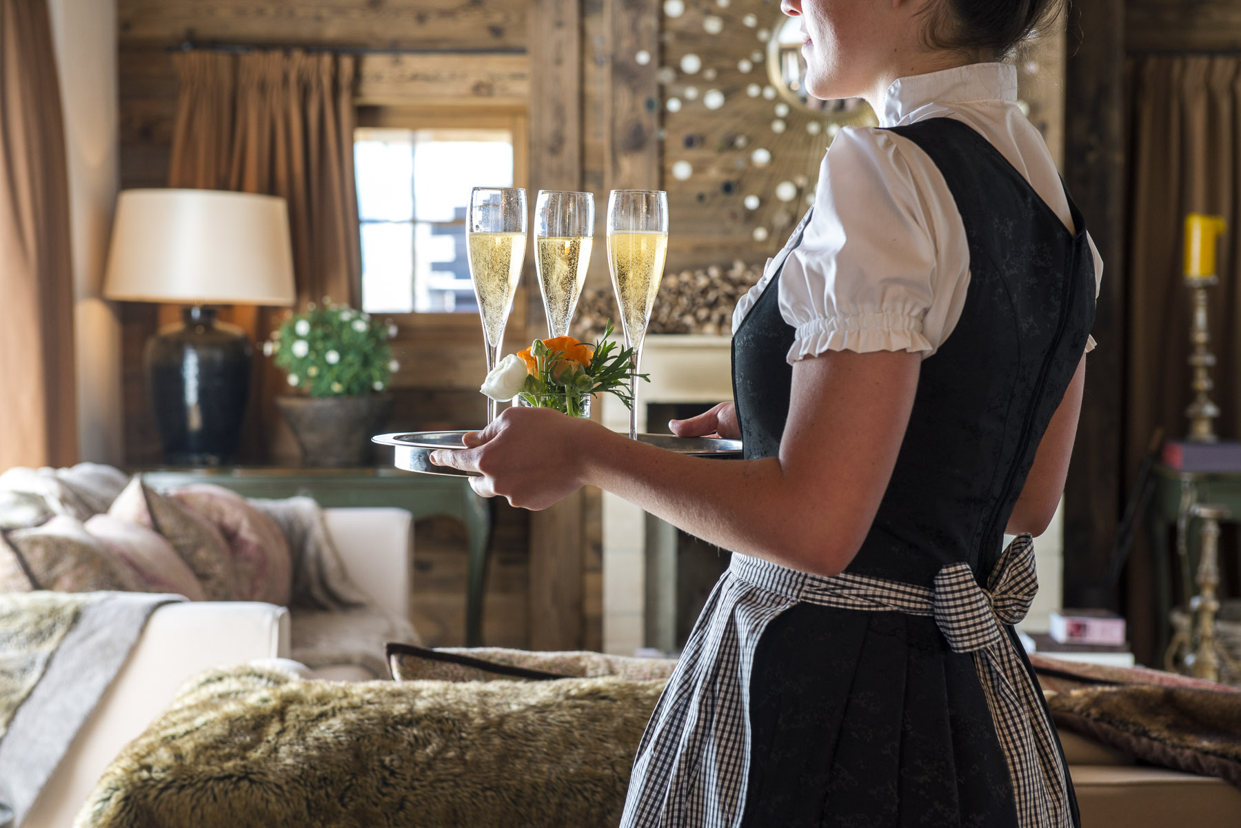 Haute Montagne's highly experienced in-chalet team serving champagne