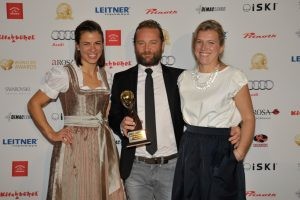 Duncan and Natasha collecting the award for Best Chalet in Austria in Kitzbühel.