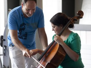 Gary Hoffman giving some guidance on the cello