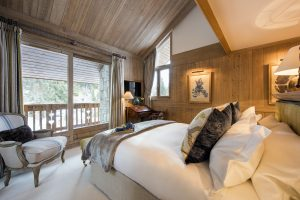 Chalet Valentine has been nominated for Best Ski Chalet in France at the World Ski Awards 2017. Here is a sumptuous bedroom with stunning views of the mountains.