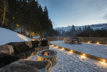 Chalet Valentine has been nominated for Best Ski Chalet in France at the World Ski Awards 2017. Here the fire pit with roaring fire outside the chalet.