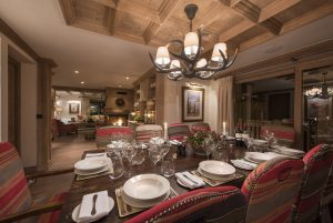 Chalet Valentine has been nominated for Best Ski Chalet in France at the World Ski Awards 2017. Here is the dining room table looking over towards the living area.