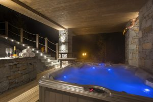 Chalet Valentine has been nominated for Best Ski Chalet in France at the World Ski Awards 2017. Here the outdoor hot tub bubbling away and lit up against the night.
