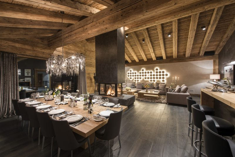 Switzerland's Best Ski Chalet: Chalet Aconcagua's The open-plan contemporary living and dining room