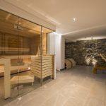 Wellness facilities include an outdoor stone bath and a sauna.