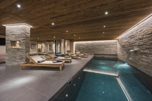 Switzerland's Best Ski Chalet nominee. Sirocco's indoor swimming pool with waterfall feature