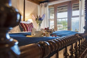 Four poster bed in one of the five bedrooms of Bella Coola in Verbier