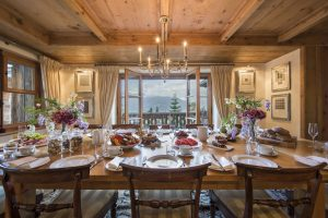 Bella Coola's dining room opens onto a deck that looks over the village and surrounding mountains