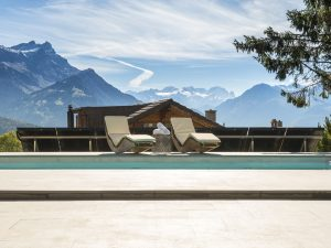 Sun loungers by the pool in your luxury ski chalet