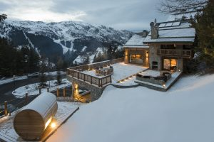 Chalet Valentine has loads of outdoor space with a barrel sauna, hot tub and firepit the chalet enjoys spectacular views of the resort and surrounding mountains.