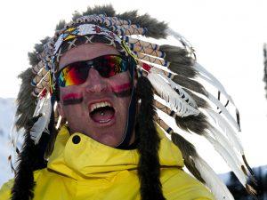 man dressed in native American headdress