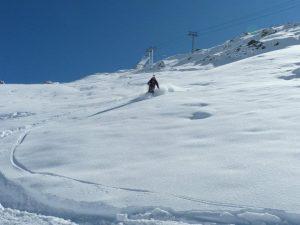 Skier on early season snow