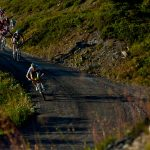 Cyclists on descent down mountain