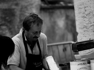 Man serving raclette