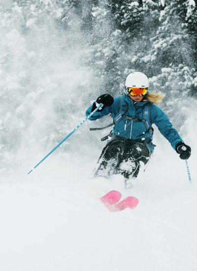 Skier kicking up fresh powder on mountain